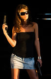 Girl with gun  in old train Stock Photography
