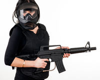 Girl with gun and paintball equipment Royalty Free Stock Photo