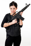 Girl with gun and paintball equipment Stock Photos