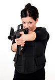 Girl with gun and paintball equipment Royalty Free Stock Images