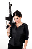 Girl with gun and paintball equipment Royalty Free Stock Photos