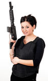 Girl with gun and paintball equipment Stock Images
