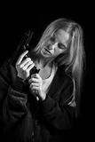 Girl with gun Stock Photography