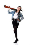 Girl and gun. A girl standing while carrying rifle Royalty Free Stock Images