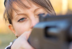 Girl with a gun for trap shooting Royalty Free Stock Photo