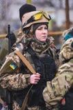 Girl with gun in uniform Royalty Free Stock Photo
