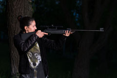 Girl with a gun in the woods. royalty free stock photo