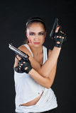Girl with guns Royalty Free Stock Photography