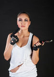 Girl with guns Royalty Free Stock Image