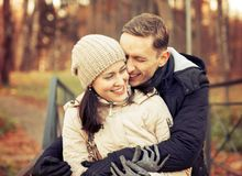 Girl with guy in autumn park. Young couple on walk in autumn park royalty free stock image