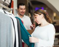 Girl and guy choosing clothes Royalty Free Stock Photo