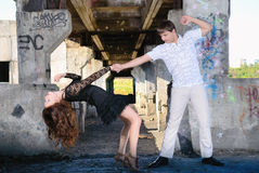 The girl with the guy dance in the thrown room Stock Photos