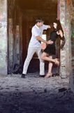 The girl with the guy dance in the thrown room Stock Images