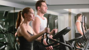 A girl and a guy do in the gym stock footage