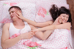 Girl and guy find out relationship morning in bed Stock Image