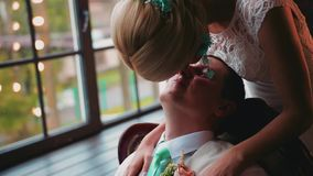 The girl and the guy gently RUB their noses against each other. Cool moment. Nice close-up. Good mood. Love and family stock video