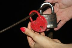 A young girl and a young boy in green forest hands on the lock stock photo