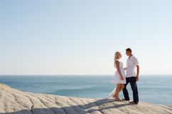 Girl and a guy going out at the sea Royalty Free Stock Photography