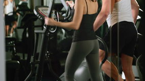 Girl and guy are in the gym stock footage