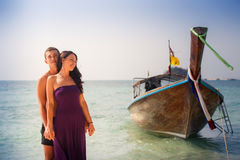girl and guy hug against longtail boat Stock Photography
