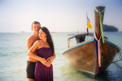 girl and guy hug against longtail boat Stock Image
