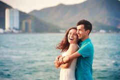 girl and guy hugging against azure sea Royalty Free Stock Images
