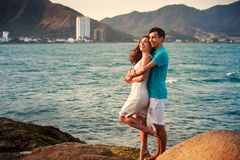 girl and guy hugging against azure sea Royalty Free Stock Photography