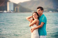 girl and guy hugging against azure sea Royalty Free Stock Photos