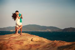 girl and guy kiss against mountains Stock Images