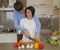 Girl and guy in the kitchen Royalty Free Stock Image