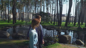 Girl and guy looking and smiling each other. stock footage