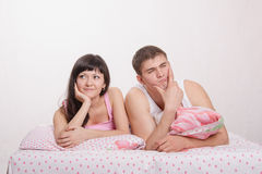 Girl and guy lying in bed dreaming Stock Image
