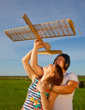 Girl and guy and model of airplane Royalty Free Stock Photo