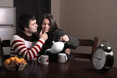Girl guy pours tea. Girl pours tea guy, while the guy stroking her face Stock Image