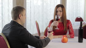 Girl and guy romantic dinner. Young couple having dinner in a restaurant in a romantic setting stock video