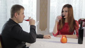 Girl and guy romantic dinner. Young couple having dinner in a restaurant in a romantic setting stock video footage