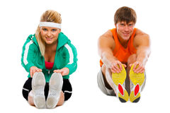 Girl and guy in sportswear making stretching Stock Photography