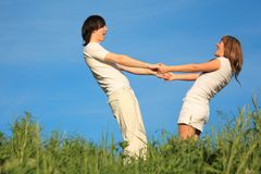 Girl and  guy stand having joined hands Royalty Free Stock Image