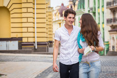 Girl and guy on the streets of European citie Royalty Free Stock Images