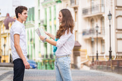 Girl and guy on the streets of European citie Stock Photo