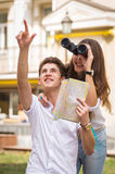 Girl and guy on the streets of European citie Stock Photography