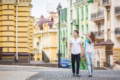 Girl and guy on the streets of European cities Stock Photography