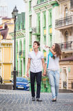 Girl and guy on the streets of European cities Royalty Free Stock Photos