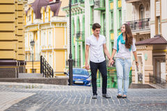 Girl and guy on the streets of European cities Royalty Free Stock Image
