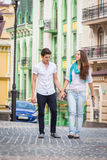 Girl and guy on the streets of European cities Stock Images
