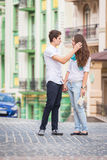 Girl and guy on the streets of European cities Stock Photo