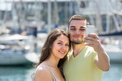 Girl and guy taking selfie in city Stock Images