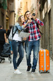 Girl and guy taking walk in city Royalty Free Stock Images