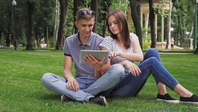 A Girl And a Guy Use a Digital Tablet stock video