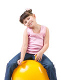 girl in gym with a  ball Royalty Free Stock Photos